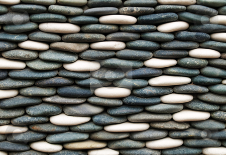 Colorful stones background stock photo, Wall made of stacked colorful stones by Laurent Dambies