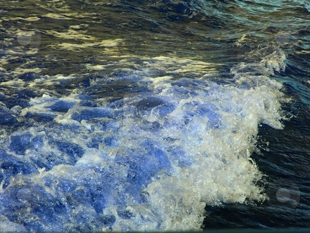 Wave stock photo, Wave after a boat in motion, the shimmer from the sun hits the bobbles by Arve Bettum
