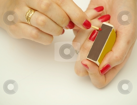 Woman with matchsticks stock photo, A woman holding matchsticks, ready to ignite by Arve Bettum