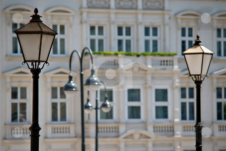 Lamps stock photo, Lamps with facade of historical building in background by Juraj Kovacik
