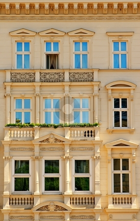 Facade with balconies stock photo, Old historical building facade with balconies by Juraj Kovacik