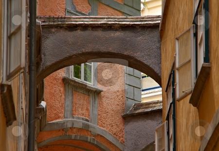 Old narrow street stock photo, Old town narrow street with a arc by Juraj Kovacik