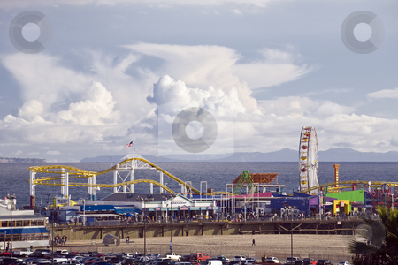 Santa Monica Pier stock photo, Crowds fill the Amusement park on Santa Monica California pier with Catalina Island in the background. by Bart Everett