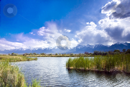 Storn Over Sierra Pond stock photo, Storm clouds gather over a placid pond in California's Eastern Sierra by Bart Everett