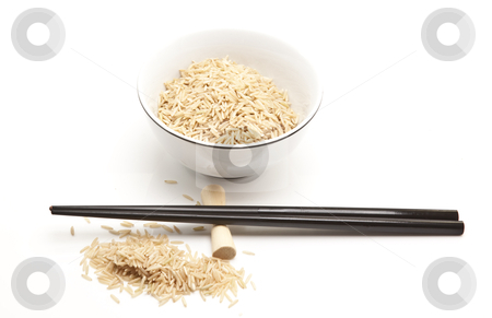 Bowl of uncooked brown rice & chopstick stock photo, Bowl of uncooked brown rice & chopstick by Jon Le-Bon