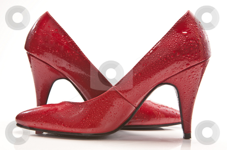 Wet Red Shoes stock photo, Wet red high heel shoes by Jon Le-Bon