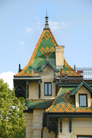 Architecture details stock photo, High green roof on yellow building over blue sky by Julija Sapic