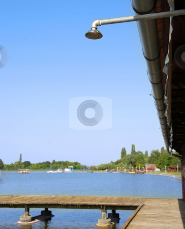 Shower by lake stock photo, Shower outdoor by blue lake with wooden pier by Julija Sapic
