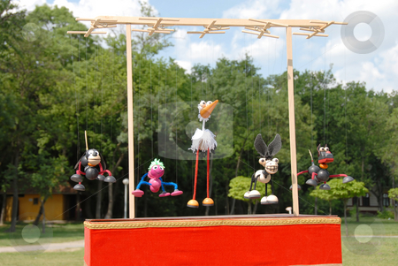 Puppets animals stock photo, Puppets animals hanging on wooden slat outdoor by Julija Sapic