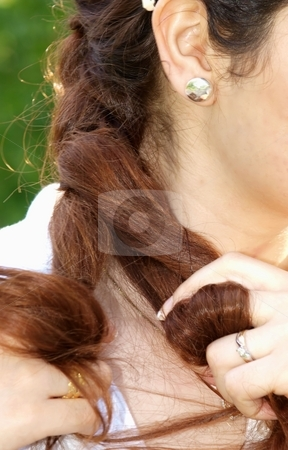 Woman hair stock photo, A female playing with the hair or fixing the hair by Arve Bettum