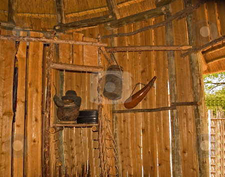 Old Rustic African Tools in Hut stock photo, This old African styled tools and equipment are hanging inside a wooden hut. by Valerie Garner