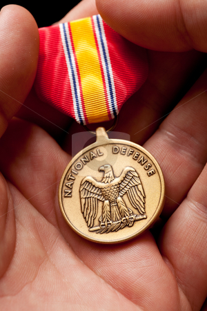 Man Holding National Defense War Medal stock photo, Man Holding National Defense War Medal in The Palm of His Hand. by Andy Dean