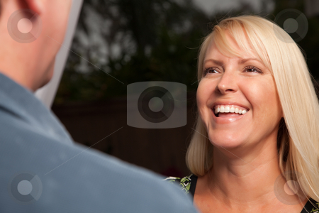 Blonde Socializing with Wine Glass stock photo, Wine Drinking Blonde Socializing with Man at an Evening Gathering. by Andy Dean