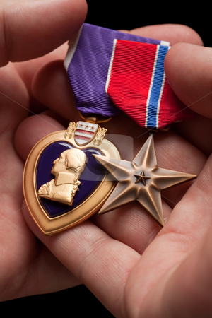 Man Holding Purple Heart and Bronze War Medals stock photo, Man Holding Purple Heart and Bronze War Medals in The Palm of His Hand. by Andy Dean