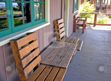 Welcoming Porch stock photo, This welcoming porch on a cabin just speaks to come sit and rest a while. by Valerie Garner