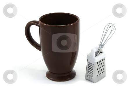 Tall brown Hot Chocolate Mug with Whisk & Grater stock photo, Tall, dark brown ceramic mug for hot chocolate drink, with mini whisk and grater by Helen Shorey