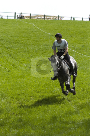 Eventing stock photo, Eventing rider galopping down a hill by Andreas Brenner