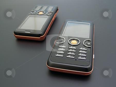 Mobile phones stock photo, Couple of the modern mobile phones by Sergej Razvodovskij