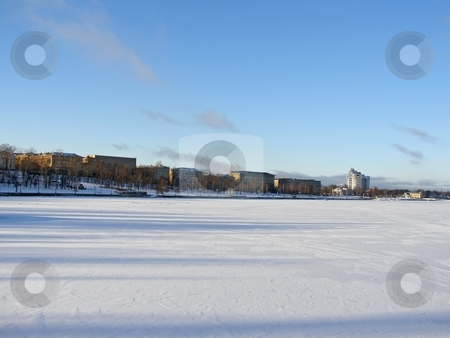 Town view stock photo, Tranquil winter lake skyline with the blue sky and town by Sergej Razvodovskij