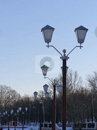 Row of lanterns stock photo, The row of the town lanterns winter season by Sergej Razvodovskij
