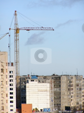 Growth town stock photo, Buildings and cranes in the growth part of town by Sergej Razvodovskij
