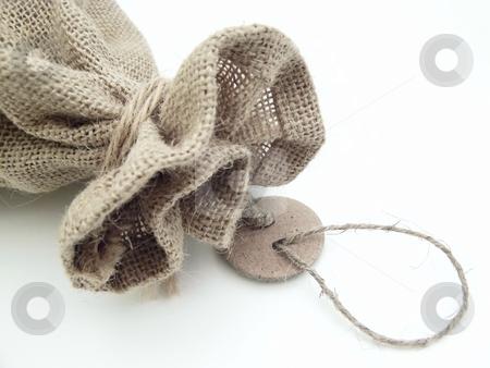 Sack with tag label stock photo, The part of the close beige linen sack with the tag label by Sergej Razvodovskij