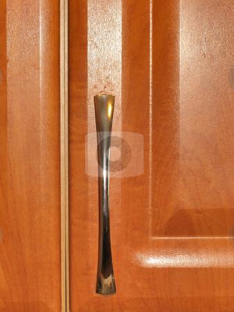 Door stock photo, The wooden brown door with metallic handle by Sergej Razvodovskij