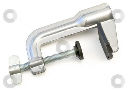 Clamp stock photo, Single metal clamp against the white background by Sergej Razvodovskij