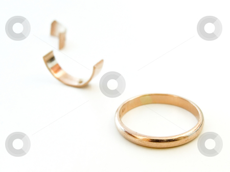 Broken ring stock photo, Golden ring with the pieces of gold against the white background by Sergej Razvodovskij