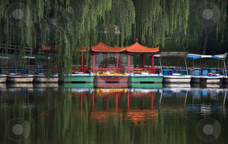 Boats and Reflections Purple Bamboo Park Beijing China stock photo, Red Boats Green Willows and Reflections Purple Bamboo Park Beijing China by William Perry