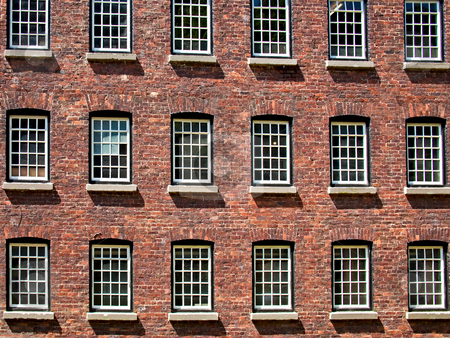 Windows stock photo, Repeating windows in a brick built structure by Norma Cornes