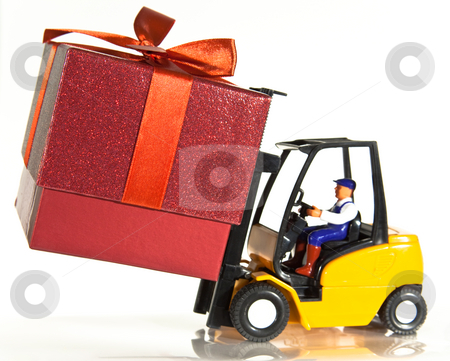 Forklift and present stock photo, A toy forklift truck delivering a red present by Norma Cornes