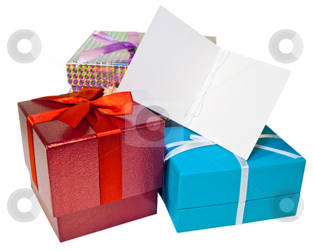 Gifts stock photo, A pile of presents and a gift tag with copy space by Norma Cornes