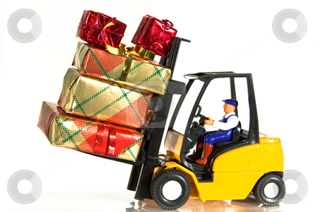 Forklift and presents stock photo, A toy forklift truck delivering a number of wrapped presents by Norma Cornes