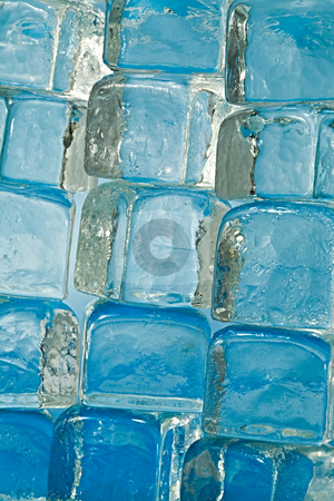 Ice cubes stock photo, A large stack of ice cubes slowly melting by Norma Cornes