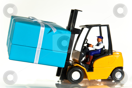 Forklift and present stock photo, A toy forklift truck delivering a wrapped present by Norma Cornes