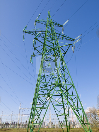 Single electricity tower stock photo, Single electricity tower against the blue sky by Sergej Razvodovskij