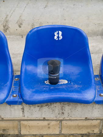 Photo lens at seat stock photo, Single photo lens at the blue stadium seat by Sergej Razvodovskij