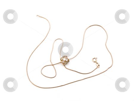 Golden necklace stock photo, Golden necklace with pendant against the white background by Sergej Razvodovskij