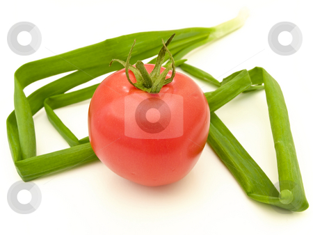 Tomato and leeks stock photo, Single red tomato and leeks against the white background by Sergej Razvodovskij