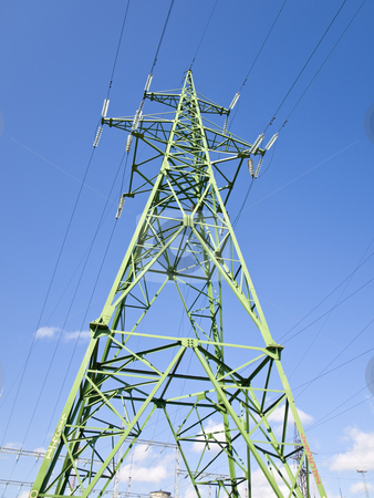 Electricity tower stock photo, Single electricity tower against the blue sky by Sergej Razvodovskij