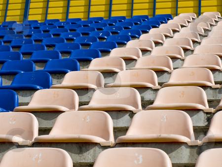 Rows stadium seats stock photo, Rows of the empty stadium blue and beige seats by Sergej Razvodovskij
