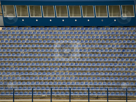 Empty stadium stock photo, Rows of the empty stadium blue seats by Sergej Razvodovskij