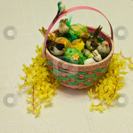 Easter basket stock photo, Easter basket filled with real or artificial straw to resemble a bird's nest. by Mariusz Jurgielewicz