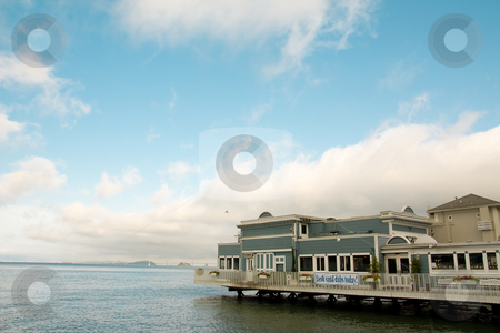 Sausalito Bay And San Francisco stock photo, View of waterside building in Sausalito, with view of San Francisco across the bay in the background. Horizontal format. by Hieng Ling Tie