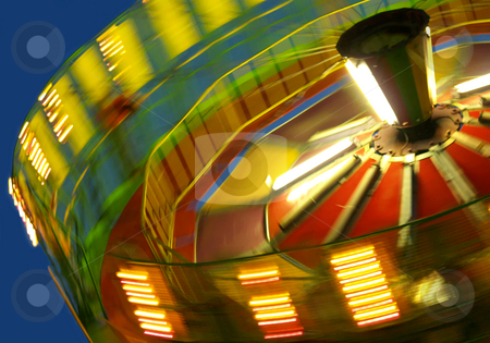 Abstract Canival Ride stock photo, Blurred motion of a spinning ride at the fair by Michelle White