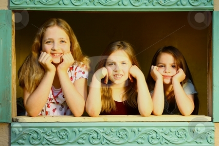 Three girls looking out dollhouse window stock photo, Three girls looking out dollhouse window by Gregory Dean