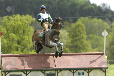 Eventing stock photo, Yann Catier jumping over obstacle by Andreas Brenner