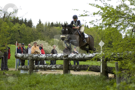 Eventing stock photo, Rider jumping obstacle by Andreas Brenner