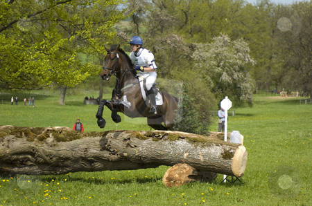 Eventing stock photo, Rider jumping trunk obstacle by Andreas Brenner